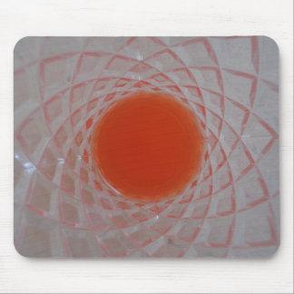 Orange drink inside a crystal glass mousepad