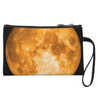 orange full moon wristlet clutch
