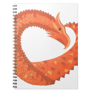 Orange heart dragon on white notebook