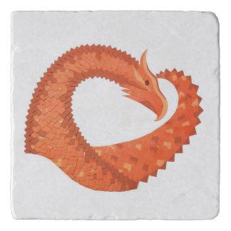 Orange heart dragon on white trivet