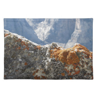 Orange lichens growing on rock face placemat