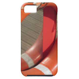 Orange lifebuoy on wooden pier in the harbor case for the iPhone 5