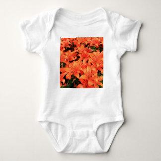 Orange liliums in bloom baby bodysuit