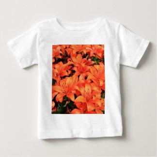 Orange liliums in bloom baby T-Shirt