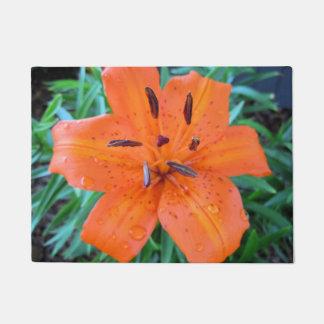 Orange Lily with water drops Doormat