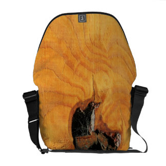 Orange natural wood with black hole and spiderweb commuter bag