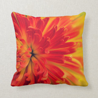 Orange-red flower throw pillow