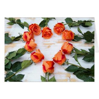 orange roses in heart form card