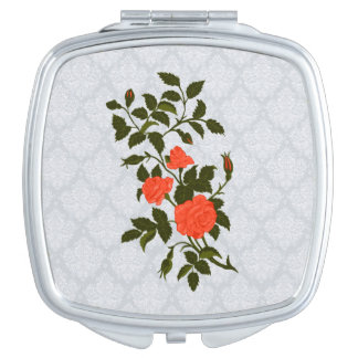 Orange Roses on Light Blue Lacy Background Makeup Mirrors