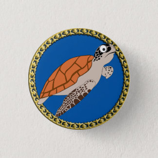 Orange sea turtle swimming with a gold frame 1 inch round button