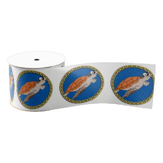 Orange sea turtle swimming with a gold frame grosgrain ribbon