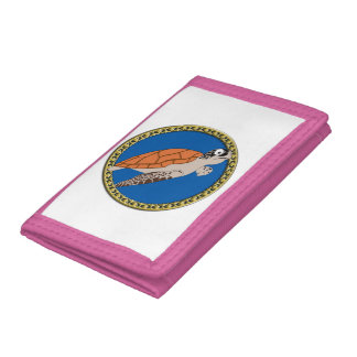 Orange sea turtle swimming with a gold frame tri-fold wallet