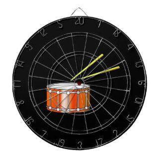 orange snare graphic with sticks dartboard with darts