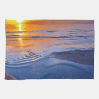 Orange sunset at sea kitchen towel