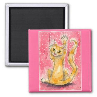 Orange tabby cat, pink magnet
