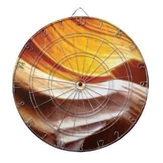 orange tan sun rocks dartboard
