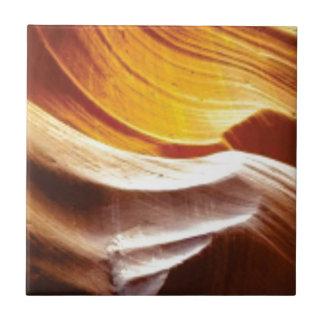 orange tan sun rocks tile