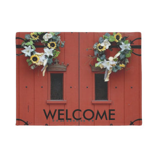 Orange Wooden Door with Wreaths Door Mat