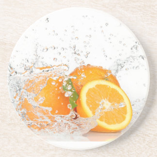 Oranges with water splashing drink coaster