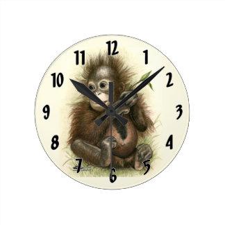 Orangutan Baby With Leaves Wallclocks