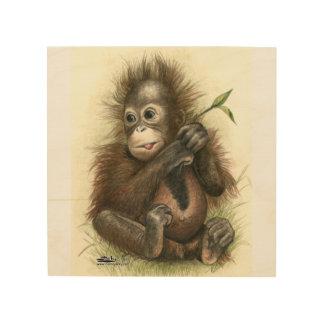 Orangutan Baby With Leaves Wood Print