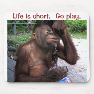 Orangutan Sitting and Playing with Water Mouse Pad