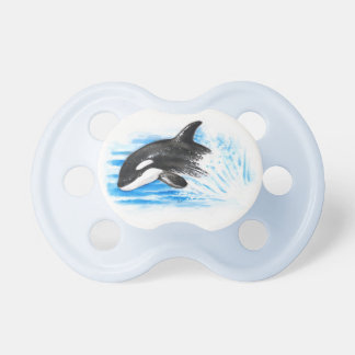 Orca Playing Baby Pacifiers