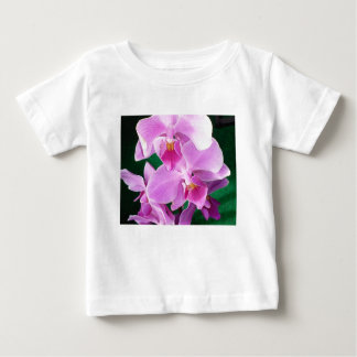 Orchid blooms closeup in pink baby T-Shirt