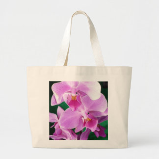 Orchid blooms closeup in pink large tote bag