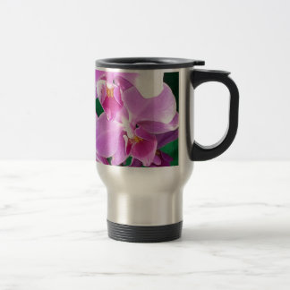 Orchid blooms closeup in pink travel mug