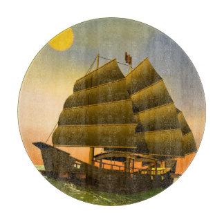 Oriental junk by sunset - 3D render Cutting Board