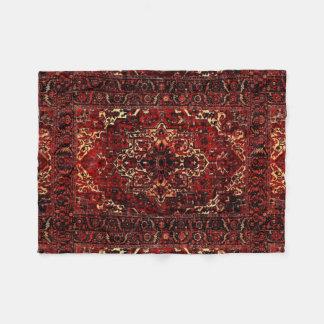 Oriental rug design in dark red fleece blanket