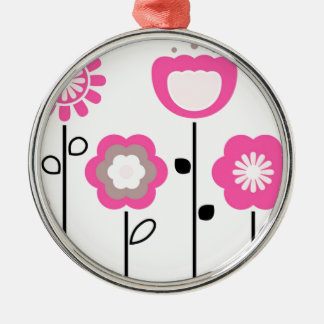 Ornamental flowers on white metal ornament
