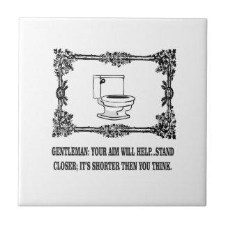 ornate male joke toilet tile