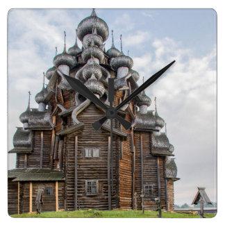 Ornate wooden church, Russia Clocks