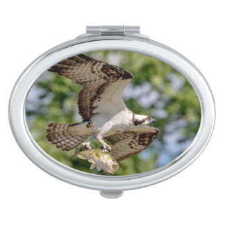 Osprey with a large mouth bass makeup mirror