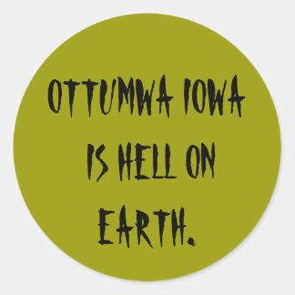 OTTUMWA IOWA IS HELL ON EARTH. ROUND STICKER