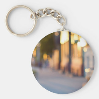 Out of focus image of streets and buildings basic round button keychain