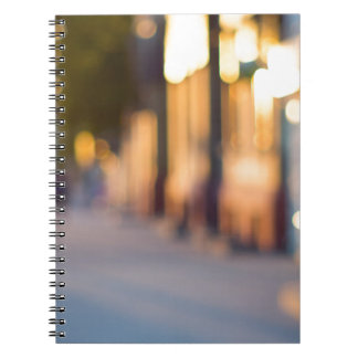 Out of focus image of streets and buildings spiral note book