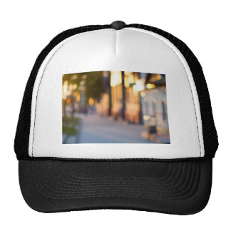 Out of focus image of streets and buildings trucker hat