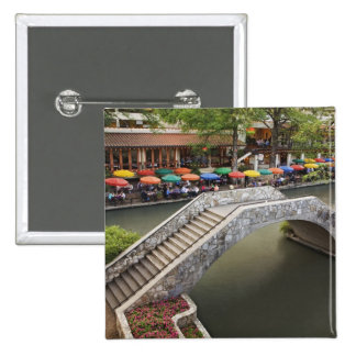 Outdoor cafe along River Walk and bridge over 2 2 Inch Square Button
