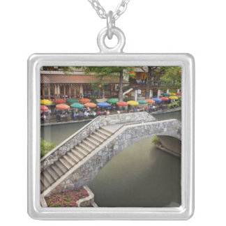 Outdoor cafe along River Walk and bridge over 2 Square Pendant Necklace