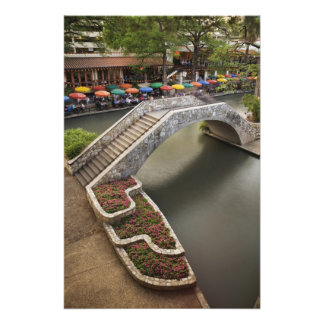 Outdoor cafe along River Walk and bridge over Photo Print
