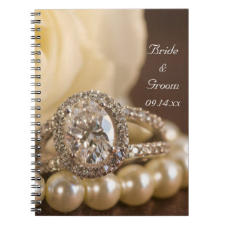 Oval Diamond Ring and White Rose Wedding Notebook