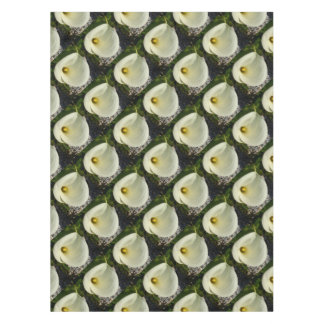 Overhead Shot of A Cream Calla Lily In Soft Focus Tablecloth