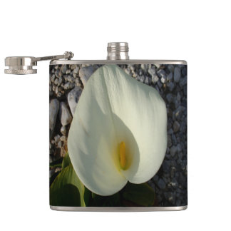Overhead View of A White Calla Lily Against Pebble Hip Flask