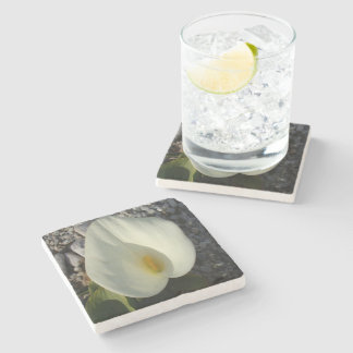Overhead View of A White Calla Lily Against Pebble Stone Coaster