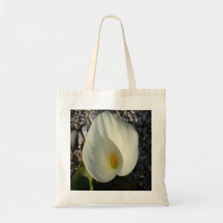 Overhead View of A White Calla Lily Against Pebble Tote Bag