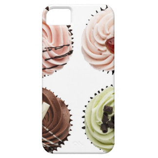 Overhead view of four cup cakes on white iPhone 5 cover