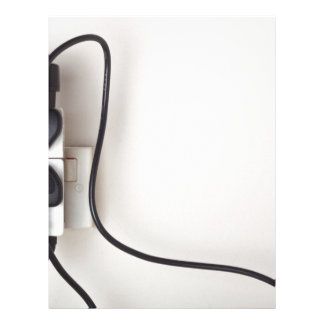 Overloaded ac power wall socket letterhead
